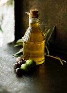 Oil in jar with natural food items by roberta-sorge-unsplash