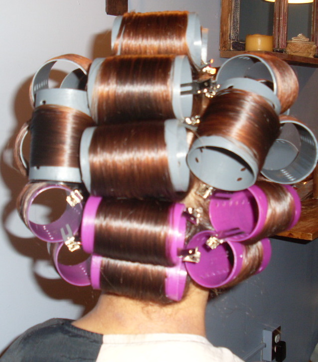 Natural curly hair with rollers for wet set service