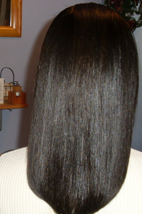 Natural curly hair thermally straightened